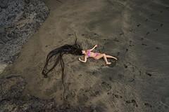 Washed up (orangeweta) Tags: beach girl hair blacksand bikini blackhair siren aarondavey
