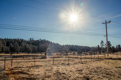 Heber Midday (jayRaz) Tags: blue trees winter arizona sky sun mountain southwest nature yellow forest fence woods backyard heber bright hill rocky dry az powerlines alpine lensflare flare shining