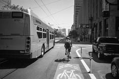 Day 152: We Get Around (mike dillon) Tags: sf sanfrancisco blackandwhite bus film bike bicycle analog 35mm canon market muni sureshot aristaedu midmarket sureshota1 slcp20 photoexif sureshotstandard32 canonsureshota1slcp20 aristaedublackandwhite400 roll0051