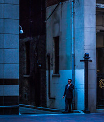 Breaktime (Graydon Armstrong) Tags: toronto alley man relaxed street suit tie corporate break smoking standing city casual 50mm dusk
