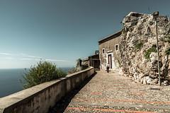 going to church-1 (mdc-photo-graphic.com) Tags: sicily italy taormina church stone wall hill sky cyan old man hot walking sun