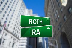 Roth IRA Street Sign On Wall Street (investmentzen) Tags: finance finances financial invest investment investing money wallstreet wall street sign roth ira retirement account plan tax deferred t