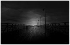Shorncliffe jetty. (agphoto100) Tags: jetty peir wood railings schorncliffe nikon 5700 rain sea monochrome blackandwhite frame dark mood gloomy