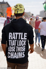 Rattle the lock. Lose those chains. (Red Cathedral uses albums) Tags: sonyalpha a77markii a77 mkii eventcoverage alpha sony colorrun sonyslta77ii slt evf translucentmirrortechnology redcathedral belgium alittlebitofcommonsenseisagoodthing activism protest oostednde oostende ostend anonymous mask guyfawkes revolution demonstration maskedface millionmaskmarch mmm2016