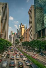 Central Plazza (Laurent Pelleray) Tags: long exposure hong kong tesla model s gratte ciels traffic street jam photography nikon central plazza reflects