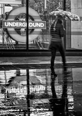 Kings Cross Rain again (branestawm2002) Tags: kings cross pancras station tube underground railway metro subway london rain weather precipitation cold wet street umbrella roundel transport commute camden euston damp reflection pavement sidewalk