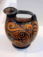 Askos (4th century BCE) 3 (Universal Pops (David)) Tags: motif floral face painting greek handle design italian ceramics flat northcarolina vessel raleigh container oil pottery lamps spout shape liquid earthenware headdress decorativearts northcarolinamuseumofart redfigure