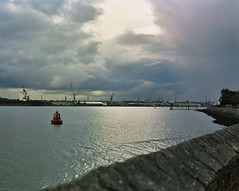 VII (Francesca Solloway) Tags: winter sea sky storm 120 water rain wall clouds port docks landscape boats grey landscapes industrial ships seawall 120film southampton industriallandscape stormclouds southamptondocks 120colourfilm landscapeandpower