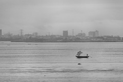 Sand Collector in Lagos Lagoon (Warriorwriter) Tags: poverty life africa people house water trash river living smog dangerous community families culture lagos safety crime pollution nigeria disease congestion pirogue crowded dugoutcanoe disparity westernafrica