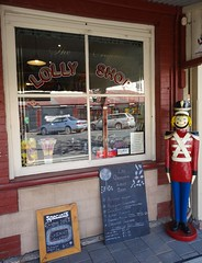 Strathalbyn. High Street. The Old Lolly Shop with soldier guard. (denisbin) Tags: strathalbyn highstreet lollyshop toysoldier soldier sweets confectionary redcoat lolly signs candy candystore bluepants