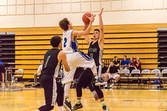 Reilly Milligan goes high to lay one up over a defender (kirkmiles) Tags: arizona basketball tucson az february falcons round1 aia 2015 divisioniii fhhs statetournament fountainhillshighschool reillymilligan tanqueverdehighschool