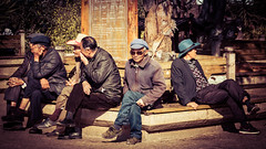 A subtle smile (Dave_Cossey) Tags: china smile bench sitting cross hats well yunnan dressed lijiang legged subtle gentlemen