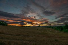 sunset over Shropshire and Herefordshire (mds63ie) Tags: ludlow leominster shropshire herefordshire hay bales sky sunset field agriculture stormy summer uk grass horizon nikon d5300 wideangle