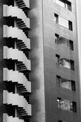 Divided Loyalties (Douguerreotype) Tags: urban monochrome glass bw blackandwhite abstract buildings mono stairs window architecture city tokyo japan wall steps