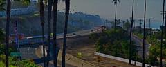 Coastal Express (MPnormaleye) Tags: 24mm train highway coastal ocean cliff mountain california pch utata pano panorama