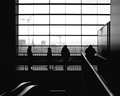 Waiting in the Shade (floressas.desesseintes) Tags: berlin station waiting publictransportation bahnhof passengers sbahn kontrast friedrichshain contrasts ostkreuz warten fahrgste schwarzweis streetfotografie