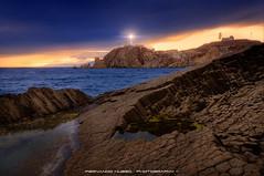The lighthouse among the rocks (Fernando Hueso Photography) Tags: blue light sunset sea espaa lighthouse seascape faro spain rocks andalucia hour almeria rocas