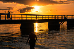 Sunset by the beach (Maria Eklind) Tags: horizon hav ribersborg bridge water brygga3 sweden outdoor light ribban summer beach ocean malm strand sunset brygga people solnedgng tbryggan sun resund siluett silhouette skneln sverige se