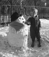 Winter is near (theirhistory) Tags: child snow kid snowman pipe hat scarf wellies snowsuit winter england wellingtonboots garden