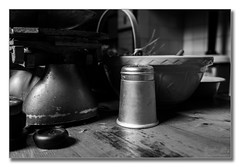 Tools of the trade (Descended from Ding the Devil) Tags: aga bw dof nationaltrust powyscastle sonya7mkii sonyalphadslr wales welshpool basket beyondbokeh blackandwhite bokeh depthoffield fullframe indoor kitchen mirrorless mixingbowl monochrome photoborder selectivefocus shaker table weighingscales weights