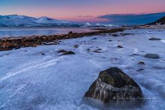emergence (pixellesley) Tags: ocean winter sunset snow mountains ice beach norway landscape twilight rocks sundown arctic fjord lowtide