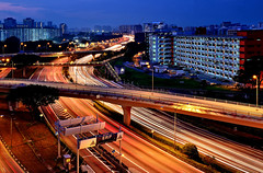 Into the Night (Rebecca Ang) Tags: lighting city light urban architecture pie twilight highway singapore apartments cityscape flats lighttrails bluehour expressway hdb thebluehour urbanarchitecture panislandexpressway housinganddevelopmentboard rebeccaang