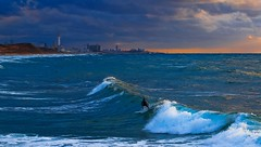 surfing in the rough sea at sunset (Lior. L) Tags: blue light sunset sea sky beach nature beautiful weather sport skyline clouds canon buildings wonderful israel telaviv amazing mediterranean waves seascapes action surfer awesome horizon stormy bluesky surfing telephoto rough canondslr mediterraneansea telephotolens stormyweather actionshot canon70200f4l extream actionphotography roughsea beautifulnature wonderfulnature hertzelia amazingnature extreamsport awesomenature hertzeliabeach horizonbeach canon600d canont3i canonkiss5 surfingintheroughseaatsunset