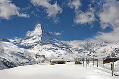 The Matterhorn , the Symbol of Switzerland. Winter paradise ,on the way to the famous Gornergrat. No. 4154. (Izakigur) Tags: schnee winter light white mountain snow money alps love nature clouds train alpes schweiz switzerland nikon europa europe flickr paradise suisse suiza symbol pov swiss snapshot feel bank trainstation sua iloveyou neige zermatt matterhorn helvetia nikkor svizzera alpi 500faves lepetitprince robbiewilliams valais choclate thelittleprince reallove cervin cervino myswitzerland ilpiccoloprincipe lasuisse 100faves 200faves montcervin swissfranc  300faves 400faves nikond700 nikkor2470f28 izakigur nikkor2470mmf28g nikon2470mmf28g