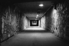 Graffiti tunnel (Janneaa) Tags: urban blackandwhite night finland lights graffiti vanishingpoint blackwhite streetlight sony tag tunnel nighttime shade kuopio vsco northernsavonia sonynex sel35f18 sonynex5n vscofilm vscofilm02
