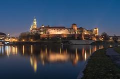Wawel castle over Vistula river (TomaszMazon) Tags: reflection castle church night river evening king cathedral towers royal illumination poland krakow wawel palace medieval lanterns baroque riverbank fortifications renaissance vistula