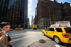 Call the taxi (Stefano Armaroli) Tags: road street city newyorkcity people usa tourism sign yellow skyscraper walking traffic manhattan citylife billboard business avenue taxy viaggi citta traffico urbanscene traveldestinations famousplace metropoli urbanroad internationallandmark theamericas starmaro stefanoarmaroli