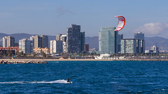Wakeboarding in Barcelona (NykO18) Tags: ocean barcelona sea people españa man building male tower beach water skyscraper landscape person coast spain europe catalonia hills shore transportation workspace manmade vehicle housing catalunya kitesurf mounds cataluña offices mediterraneansea lasgolondrinas naturalelement