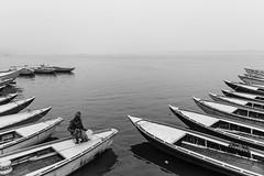 Dormancy @ Ganges | Varanasi,India (vjisin) Tags: travel light blackandwhite india white bird heritage water monochrome river boats boat nikon asia outdoor background varanasi shape hindu hinduism boatman ganga ganges ghats kasi travelphotography incredibleindia inexplore