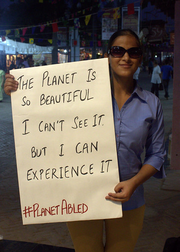 Poster Campaign: Binni, with a poster which reads, 'the planet is so beautiful. I can't see it. But I can experience it.'
