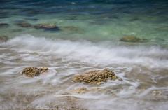 Vassiliki sea (Debs Bowness Photography) Tags: bluesea mediterranean greece vassiliki cove clearsky waves rocks greekisland
