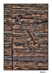 The old wooden door (Artico7) Tags: door wood old italy colour handle wooden iron fuji lock steel entrance rusty rusted porta locked scraped ruined legno friuli ruggine pordenone ferro vecchia maniglia polcenigo xe1