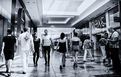 hustle bustle in west quay (sure2talk) Tags: hustlebustleinwestquay hustlebustle westquay southampton shopping shoppingcentre people blackandwhite nikond7000 nikkor1855mmf3556afs