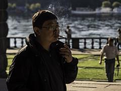 Smoke on the water (Markus Jansson) Tags: smoke smoking smoker candid tourist street streetphotography stockholm cityhall morning morninglight