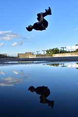The reflection of talent... (jordangillardpk) Tags: reflection boy person puddle carpark blue sky colour color pic photo extremesport breakdance gymnast trick wow epic nikon photography amazing cool flips extreme freerunning parkour