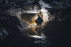 Man in cave with limestone formation (Effecs) Tags: cave limestone formations reflection underground lake nature