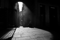 Loneliness (Sergi_Escribano) Tags: noircity barcelonastreetphotography streetphotography city laboqueria monochrome blackandwhite barcelona monocromtico mist thefog foggy light shadows dark darkness lightanddarkness sunrise dawn sky streetsofbarcelona streetshot streets architecture
