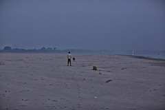 Ganga Beach (alisdair jones) Tags: dog india man beach water river sand ganga ganges ef85mmf12liiusm