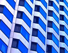 blue stripe windows - (Explore) (Demetrios Lyras) Tags: blue windows abstract building art architecture hotel angle fav50 ngc highrise curtains tenderloin fav10 fav5 linescurves fav25 fav100 fav150 sanfranciscocausa fav75 anglesanglesangles 100faves123 fav125