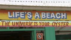 Life's a beach (Val in Sydney) Tags: beach sign restaurant sydney australia palm nsw australie