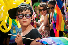 Canadian Pride (laskaproject) Tags: boy portrait sun sunlight toronto canada face glasses march rainbow walk flag pride celebration prideparade lgbt mapleleaf equality gayrights baseballcap