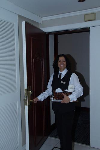 Female Hotel Working Opening Door / Travailleuse en hôtellerie ouvrant une porte