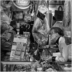 Yes, we do have Mangalica ham. (John Riper) Tags: street people bw white black holland netherlands monochrome shop john square photography mono hall market zwartwit candid streetphotography ham butcher prosciutto jamon jambon vierkant straatfotografie markthal mangalica riper johnriper