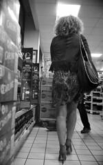 Late Night Shopper (4foot2) Tags: brighton streetphoto streetshot street streetphotography reportage reportagephotography people peoplewatching peopleofbrighton interestingpeople girl legs skirt mini miniskirt shortskirt heels highheels stilettos killerheels sexy sexygirl afterdark nightphotography night shop shopping analogue film filmphotography 35mmfilm 35mm 35mmf2 35mmf2summicron summicron leica leicam3 m3 monochrome mono bw blackandwhite kodak kodaktrix trix diafine 1200iso 1200asa shootfromthehip fourfoottwo 4foot2 4foot2photostream 4foot2flickr