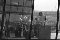 L1021491 (Sigfrid Lundberg) Tags: smoker pipesmoker copenhagen window denmark kastrupairport man escalator