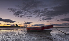 Lindisfarne light (Elidor.) Tags: sunrise holyisland lindisfarne northumberland northeast island castle boat faithful clouds morning dawn elidor d90